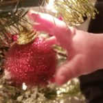 baby-hand-touching-ornament