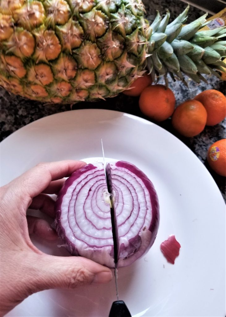Cut the onion crosswise with the stem up.