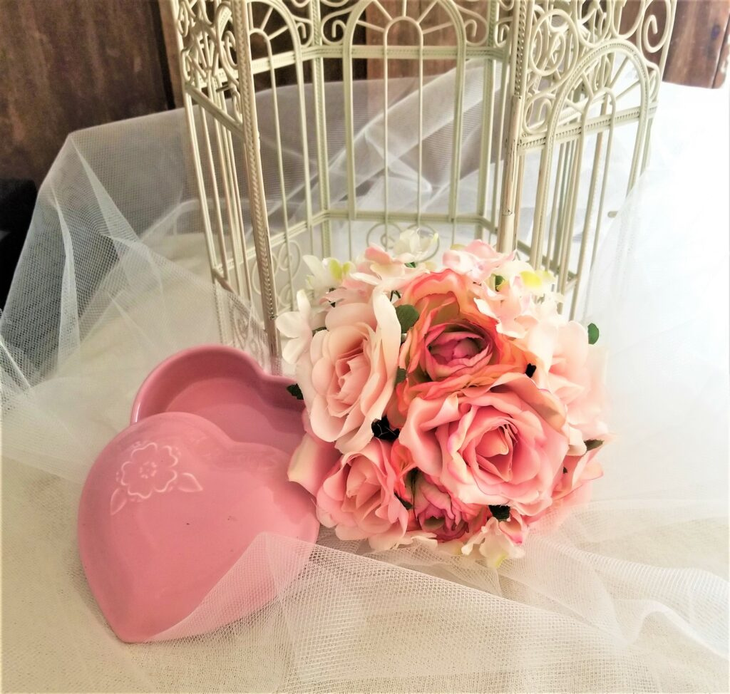 bridal bouquet and birdcage