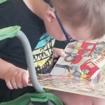 boy reading timberdoodle board book